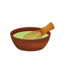 Whisk in a cup with green batter vector