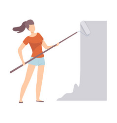 Woman paints the wall with roller in grey color vector