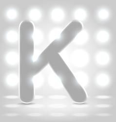 K over lighted background vector