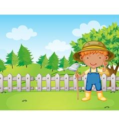 A boy holding a rake vector