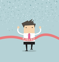 Businessman running success at the finish line vector image vector image