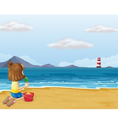 A young girl playing with the sand in the beach vector image