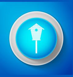 white bird house icon isolated on blue background vector image