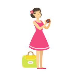 Young woman with suitcase wearing in a pink dress vector