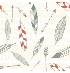 Seamless tribal pattern with feather and arrows in vector image