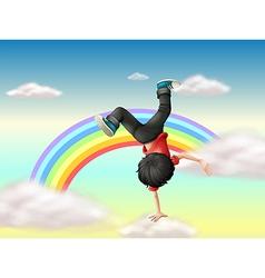 A boy performing a break dance along the rainbow vector