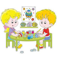 children painting easter eggs vector image
