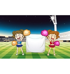 Two cheerdancers holding an empty banner vector