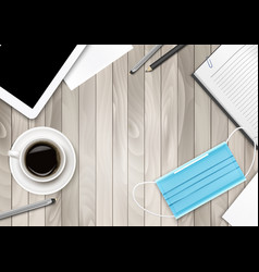 Covid-19 prevention concept on wooden office vector