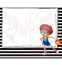 A boy playing basketball vector image vector image