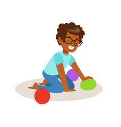 little boy sitting and playing with colorful balls vector image vector image