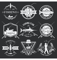 Fishing white emblems on black background vector