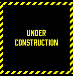 Under construction label with yellow and black vector