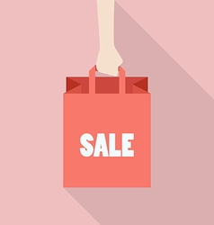 Hand hold shopping bag in flat style vector image vector image