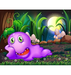 A violet monster resting under the tree in the vector image