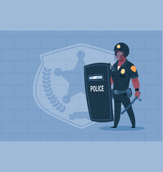 african american policeman hold shield wearing vector image vector image