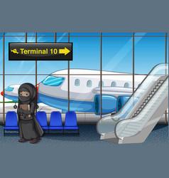 Muslim girl at airport terminal vector