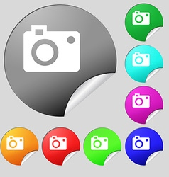 camera icon sign Set of eight multi colored round vector image