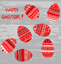red easter eggs on wooden background vector image