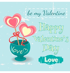 Two lollipop hearts in a vase vector image vector image