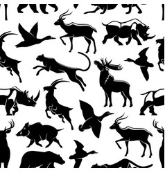 Seamless pattern of wild animals and birds vector