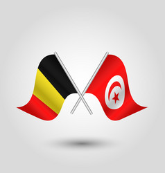 Two crossed belgian and tunisian flags vector