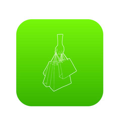 a hand holding shopping bags icon green vector image