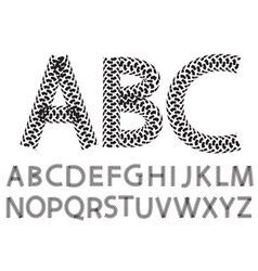 alphabet letters made from motorcycle tire tracks vector image
