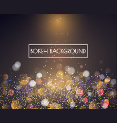 gold bokeh lights and glitter background vector image