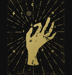 Gold witchs hand with light rays and symbols of vector