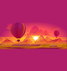 hot air balloons flying above fields and mountains vector image