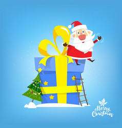 santa claus sit on the big new year gift vector image