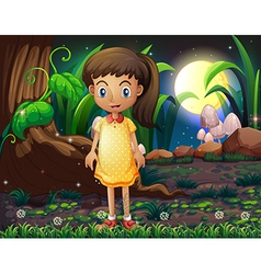 A little girl in the forest wearing a yellow vector image vector image