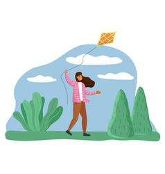 smiling happy girl in park playing with a kite vector image