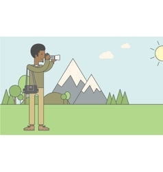 Photographer taking photo in mountains vector image