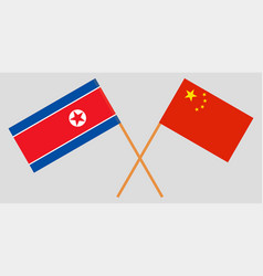 crossed north korea and republic of china flags vector image