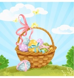 Basket with Easter eggs on the lawn vector image