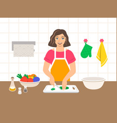 Young woman cuts vegetables for salad in kitchen vector