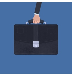 Hand holding a briefcase over blue background vector image