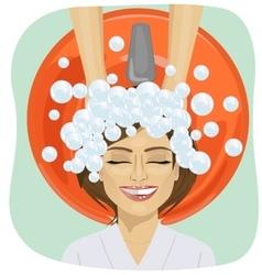 Hair washing at hairdressing salon young girl vector
