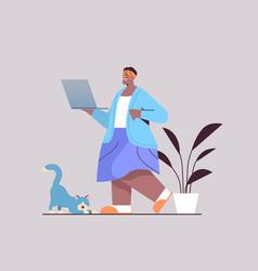 senior woman using laptop african american vector image