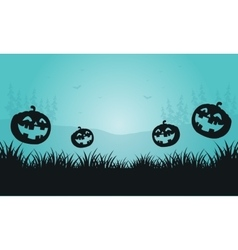 Silhouette of pumpkins and foggy Halloween vector