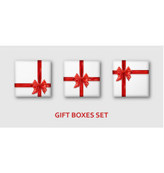 white gift boxes with red ibbons and bows vector image
