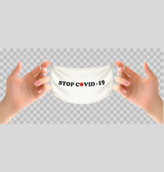 Two hands holding a medical mask stop coranavirus vector