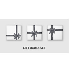 white gift boxes with silver ribbons and bows vector image