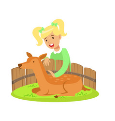 cute little girl petting lying deer in a mini zoo vector image vector image