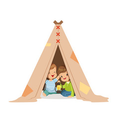 Cute little boys sitting in a tepee tent with a vector