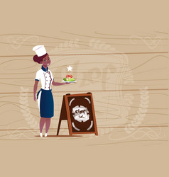 Female african american chef cook holding vector
