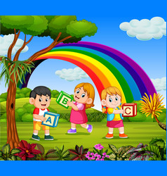 children play and hold their alphabet box vector image