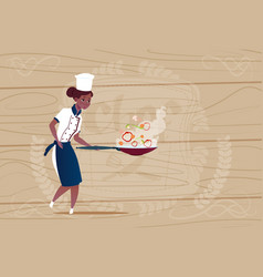 Female african american chef cook holding frying vector